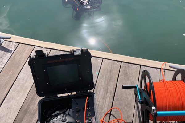 Complete SRV-8 system: ROV in water with topside box sitting on dock