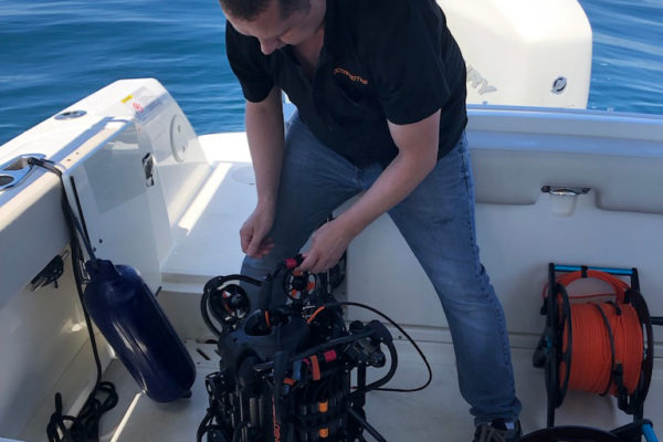 SRV-8 remotely operated underwater vehicle setup on boat with oceanbotics team