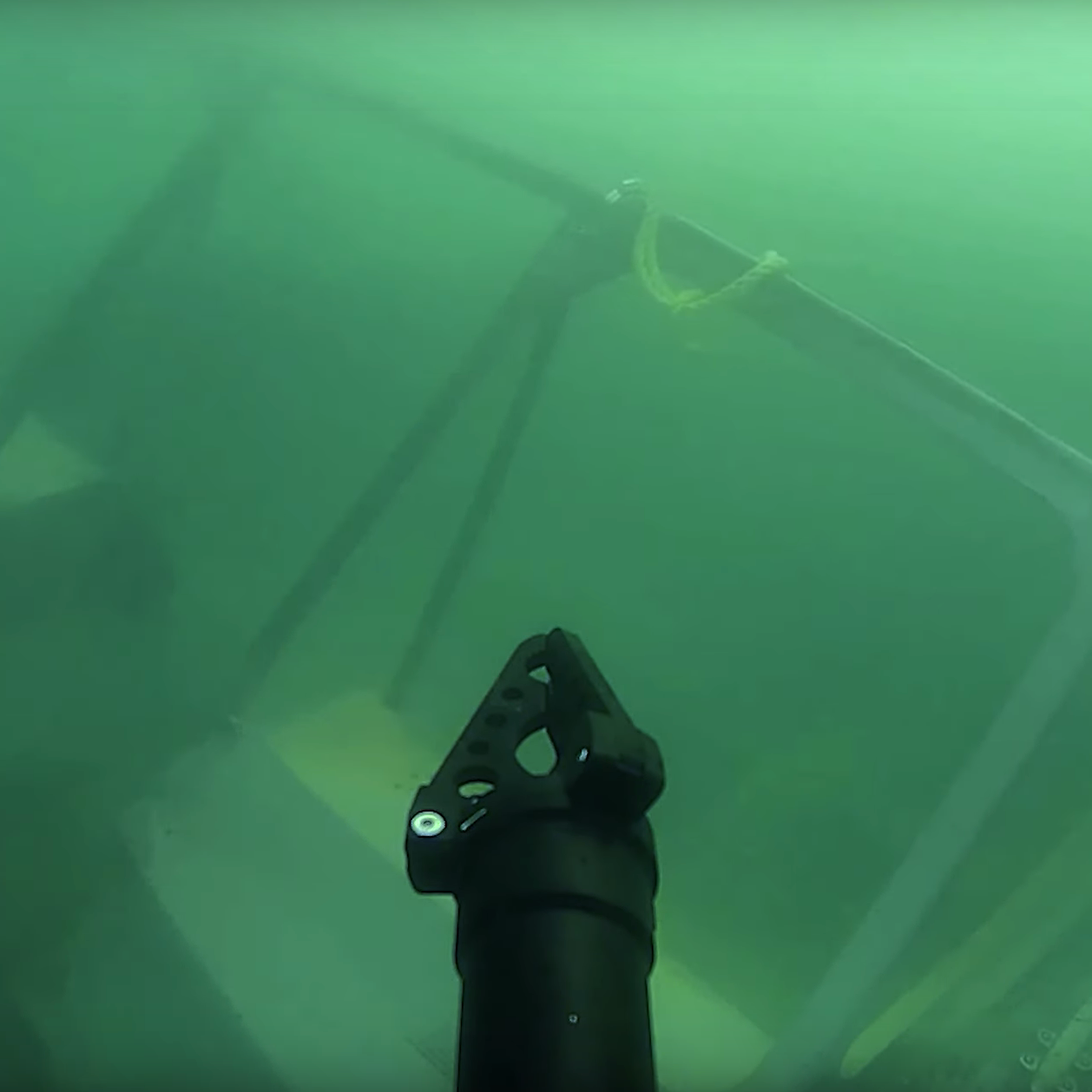 SRV-8 remotely operated underwater vehicle underwater view with grabber near shipwreck